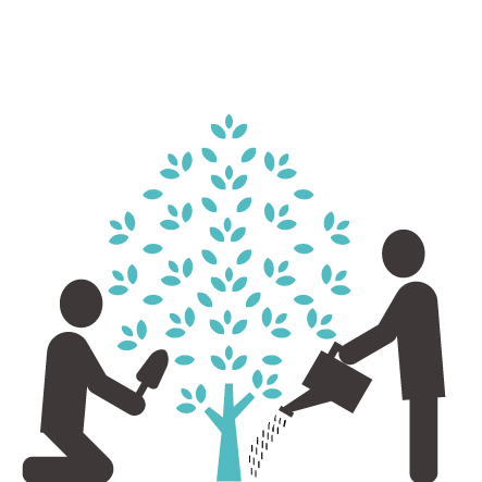 Two people watering a tree